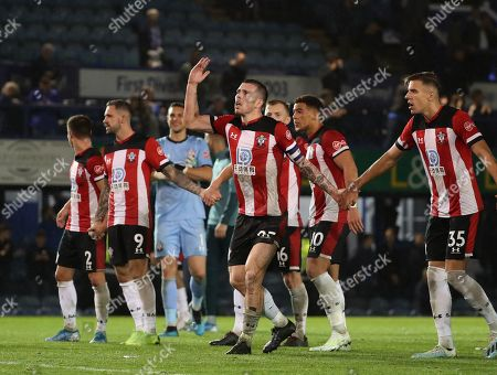 Oriol Romeu of Southampton celebrates at the end of the game with his teammates.