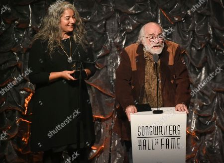 Robert Hunter, Trixie Garcia. Honoree Robert Hunter, right, and Trixie Garcia accepting the award for her father Jerry Garcia at the 46th Annual Songwriters Hall Of Fame Induction and Awards Gala in New York. Hunter, the man behind the poetic and mystical words for many of the Grateful Dead's finest songs, died, at his Northern California home, according to Grateful Dead drummer Mickey Hart. He was 78