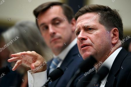 Jay Clayton, Robert Jackson Jr. Securities and Exchange Commission (SEC) Chairman Jay Clayton, right, gestures while speaking, next to SEC Commissioner Robert Jackson Jr., during a House Financial Services Committee hearing, on Capitol Hill in Washington