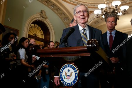 Mitch McConnell, John Thune. Senate Majority Leader Mitch McConnell of Ky., smiles as he speaks to members of the media, next to Sen. John Thune, R-S.D., right, after a Republican policy luncheon on Capitol Hill in Washington