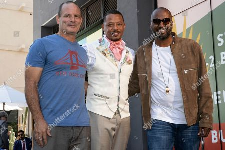 Stock Picture of Terrence Howard (C) poses with US author Dito Montiel (L) and US film director Malcolm D. Lee (R) as he is honored with a star on the Hollywood Walk of Fame, in Los Angeles, California, USA, 24 September 2019. Howard received the 2674th star on the Hollywood Walk of Fame, dedicated in the category of Television.