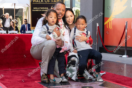 Stock Photo of Terrence Howard pose with his partner Miranda Pak and his children as he is honored with a star on the Hollywood Walk of Fame, in Los Angeles, California, USA, 24 September 2019. Howard received the 2674th star on the Hollywood Walk of Fame, dedicated in the category of Television.
