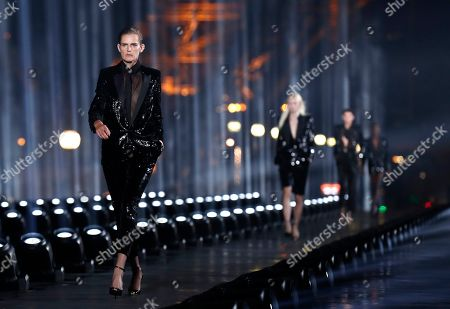 British model Stella Tennant presents a creation from the Women Spring/Summer 2020 collection by Saint Laurent fashion house during the Paris Fashion Week, in Paris, France, 24 September 2019. The presentation of the Women's collections runs from 23 September to 01 October.