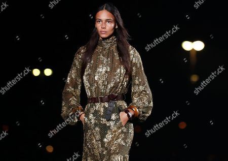 Stock Photo of US model Binx Walton presents a creation from the Women Spring/Summer 2020 collection by Saint Laurent fashion house during the Paris Fashion Week, in Paris, France, 24 September 2019. The presentation of the Women's collections runs from 23 September to 01 October.