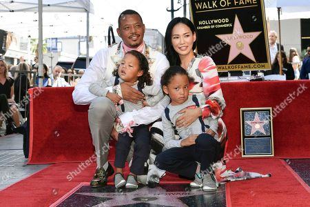Stock Image of Terrence Howard, Miranda Pak. Terrence Howard, left, Miranda Pak and their sons Hero, left, and Qirin attend a ceremony honoring him with a star on the Hollywood Walk of Fame, in Los Angeles