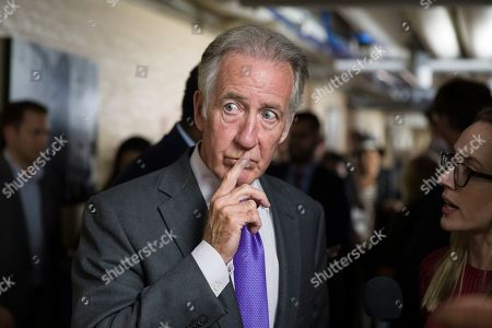 Stock Photo of House Ways and Means committee Chairman Richard Neal, of Mass., listens to a reporter's question as House democrats arrive for a caucus meeting, in Washington