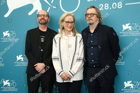 "Steven Soderbergh, Meryl Streep, Gary Oldman. Director Steven Soderbergh, from left, and actors Meryl Streep and Gary Oldman at the photo call for the film ""The Laundromat"" at the 76th edition of the Venice Film Festival in Venice, Italy. The film will be released in U.S. theaters on Sept. 27"