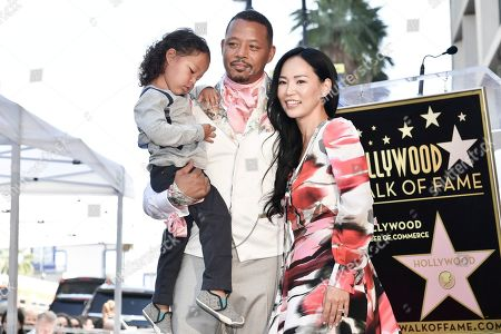 Stock Picture of Terrence Howard, Miranda Pak. Terrence Howard, left, Miranda Pak and their child attend a ceremony honoring him with a star on the Hollywood Walk of Fame, in Los Angeles