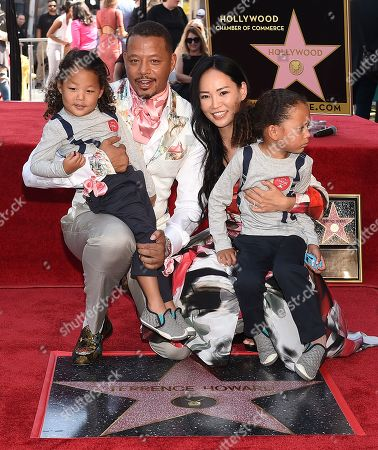 Stock Photo of Terrence Howard, Mira Pak Howard with their children