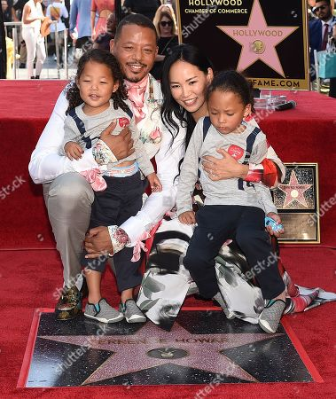 Stock Picture of Terrence Howard, Mira Pak Howard with their children