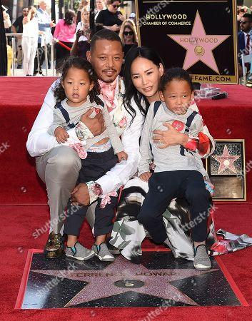 Terrence Howard, Mira Pak Howard with their children