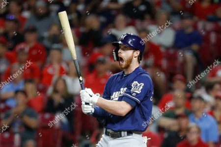 Milwaukee Brewers' Cory Spangenberg reacts to a swinging strike against Cincinnati Reds relief pitcher Matt Bowman during the eighth inning of a baseball game, in Cincinnati