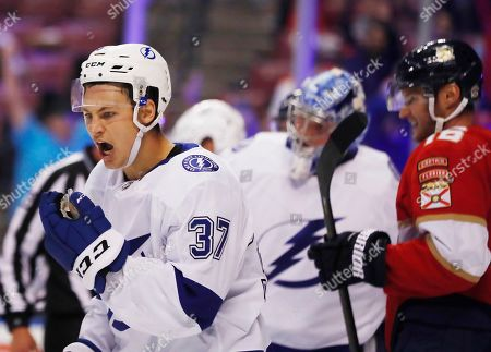 Stock Image of Nick Bjugstad, Yanni Gourde. Tampa Bay Lightning's Yanni Gourde (37) reacts after the Florida Panthers score during the second period of a preseason NHL hockey game, in Sunrise, Fla