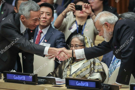 Sheikh Hasina, Lee Hsien Loong, Narendra Modi. Singapore Prime Minister Lee Hsien Loong, left, and Indian Prime Minister Narendra Modi, right, reaches across Bangladesh Prime Minister Sheikh Hasina, center, for a hand shake during a special event commemorating the 150th anniversary of Mahatma Gandhi, during the United Nations General Assembly, at U.N. headquarters