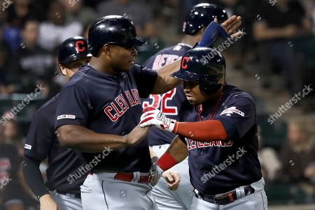 Jose Ramirez, Yasiel Puig. Cleveland Indians' Jose Ramirez, right, celebrates with Yasiel Puig, after Ramirez's three-run home run off Chicago White Sox's Hector Santiago during the third inning of a baseball game, in Chicago