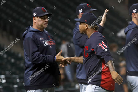 Terry Francona, Jose Ramirez. Cleveland Indians manager Terry Francona, left, and Jose Ramirez celebrate the team's 11-0 win over the Chicago White Sox in a baseball game, in Chicago