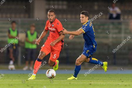 William Troost-Ekong of Udinese and Marius Stepinski of Verona