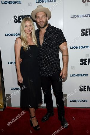 """Jai Courtney, Mecki Dent. Jai Courtney, right, and Mecki Dent arrive at a special screening of """"Semper Fi"""", and ArcLight Hollywood Cinemas in Los Angeles"""