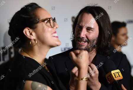"""Keanu Reeves, Karina Miller. Keanu Reeves, right, and producer Karina Miller arrive at a special screening of """"Semper Fi"""", and ArcLight Hollywood Cinemas in Los Angeles"""