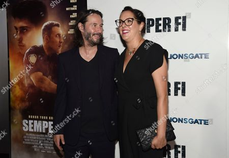 """Keanu Reeves, Karina Miller. Keanu Reeves, left, and producer Karina Miller arrive at a special screening of """"Semper Fi"""", and ArcLight Hollywood Cinemas in Los Angeles"""