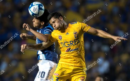 Stock Photo of Carlos Salcedo (R) of Tigres vies for the ball with Diego Abella (L) of Puebla during the Apertura Tournament (Liga MX) soccer match between Tigres and Puebla at Universitario stadium in Monterrey, Mexico, 24 September 2019.
