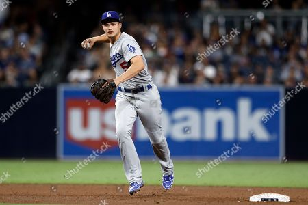 Los Angeles Dodgers shortstop Corey Seager throws to first for the out on San Diego Padres' Luis Urias during the sixth inning of a baseball game, in San Diego