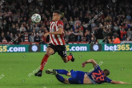 25th September 2019 , Bramall Lane, Sheffield, England; EFL Carabao Cup Football, Third round, Sheffield United vs Sunderland ; Ravel Morrison (14) of Sheffield United chips the ball over Laurens De Bock (28) of Sunderland  Credit: Mark Cosgrove News Images English Football League images are subject to DataCo Licence
