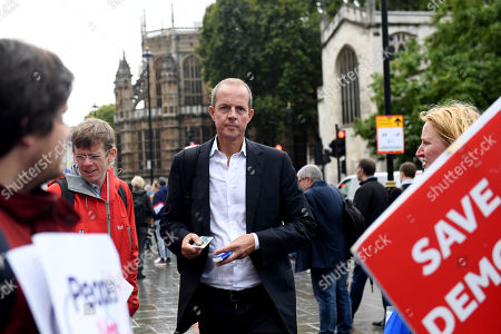 Nick Boles arrives at the Houses of Parliament after the end of the prorogation.