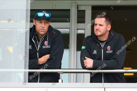 Marcus Trescothick of Somerset and Steve Davies of Somerset on the team balcony as play is abandoned for the day due to a wet outfield after heavy overnight rain during the Specsavers County Champ Div 1 match between Somerset County Cricket Club and Essex County Cricket Club at the Cooper Associates County Ground, Taunton