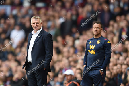 Stock Picture of Dean Smith manager of Aston Villa and John Terry look on.