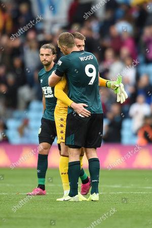 Jack Grealish of Aston Villa.Goalkeeper Tom Heaton of Aston Villa is hugged by Chris Wood of Burnley.