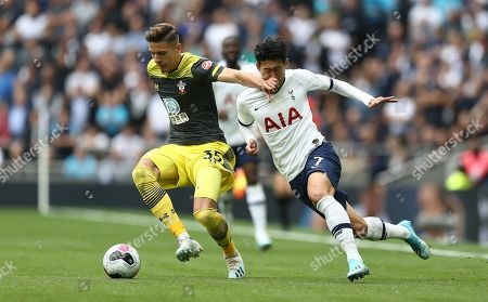 Jan Bednarek of Southampton battles with Heung-Min Son of Tottenham Hotspur
