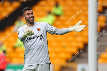 Watford goalkeeper Ben Foster gestures to the Wolves fans
