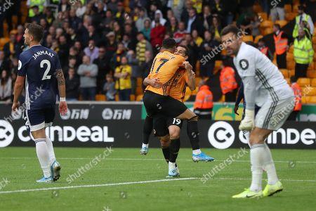 Jonny of Wolverhampton Wanderers and Morgan Gibbs-White celebrates the own goal of Daryl Janmaat of Watford