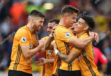 Morgan Gibbs-White of Wolverhampton Wanderers celebrates the own goal of Daryl Janmaat of Watford