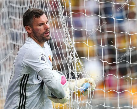 Watford goalkeeper Ben Foster gets tangled in the net