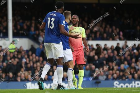 Yerry Mina of Everton and Raheem Sterling of Manchester City exchange words