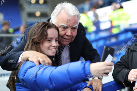 Stock Picture of Everton Chairman Bill Kenwright poses for a selfie with a fan prior to kick-off