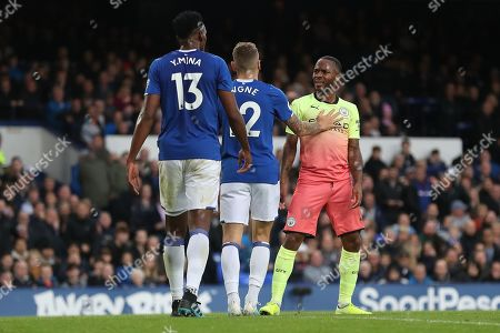 Raheem Sterling of Manchester City verbally clashes with Yerry Mina of Everton