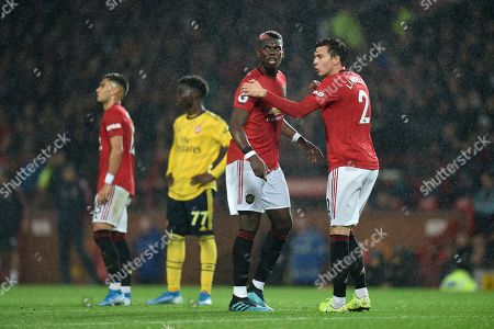 Paul Pogba of Manchester United and Victor Lindelof of Manchester United.