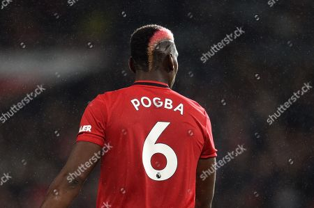 Paul Pogba of Manchester United with a red stripe in his hair.