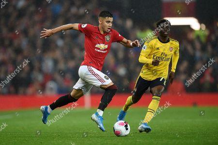 Andreas Pereira of Manchester United and Bukayo Saka of Arsenal.