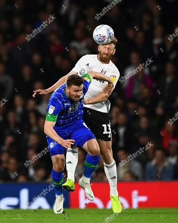 Tim Ream of Fulham battles with Lee Evans of Wigan Athletic