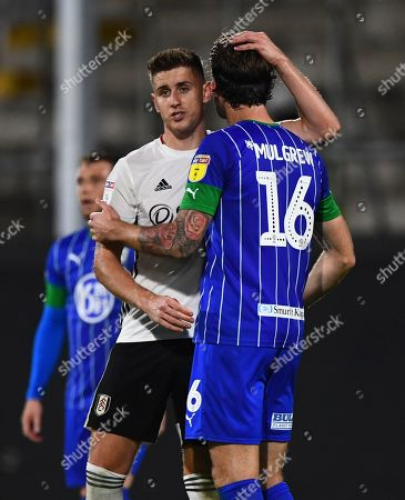 Tom Cairney of Fulham shakes hands with Charlie Mulgrew of Wigan Athletic at full time