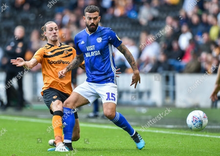 Marlon Pack of Cardiff City tackled by Jackson Irvine of Hull City