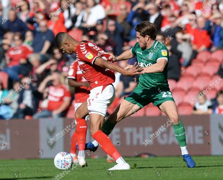 Ashley Fletcher of Middlesbrough fends off Sam Hutchinson of Sheffield Wednesday