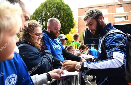 Charlie Austin of West Bromwich Albion signs autographs after returning to QPR as an opposition player for the first time since leaving