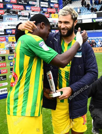 Stock Photo of Nathan Ferguson of West Bromwich Albion hugs Charlie Austin after being named man of the match