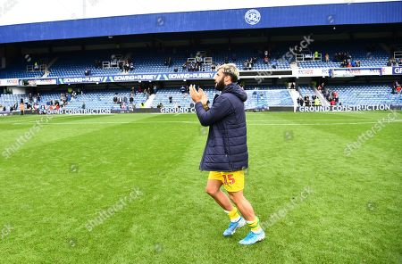 Charlie Austin of West Bromwich Albion takes time to applaud the remaining QPR fans following the final whistle