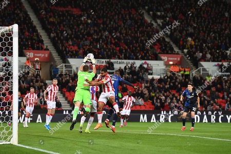 Goal Keeper Jack Butland of Stoke City almost gets to thew ball but collides with Lewis Grabban of Nottingham Forest.